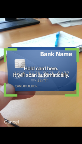 XFINITY My Account app screen shows card being scanned using mobile phone camera.